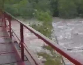 Il torrente Erro ingrossato dalle piogge sugli Appennini