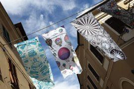 Flag Show a Novi vale il viaggio in Italia: i complimenti del critico d'arte internazionale